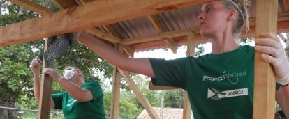 A team from Projects Abroad take part in construction volunteering in Jamaica to build playhouse for local school